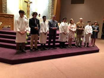 Four Students Initiated into the Catholic Church