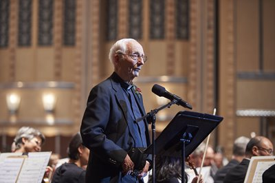 Fr. Streicher receiving the 2015 MAGIS Award